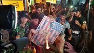 تظاهرات خشمگین عراقی ها در برابر مقر سفارت بحرین در بغداد + عکس